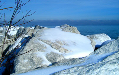 Snow-covered rocks on Lake Michigan's edge