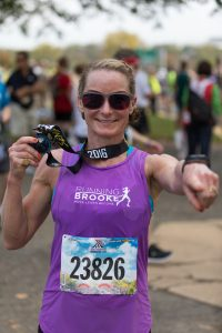 Brooke at 2016 Marine Corps Marathon with Finishers Medal